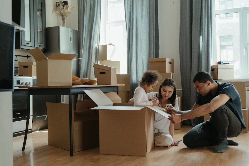 family moving to new home with boxes