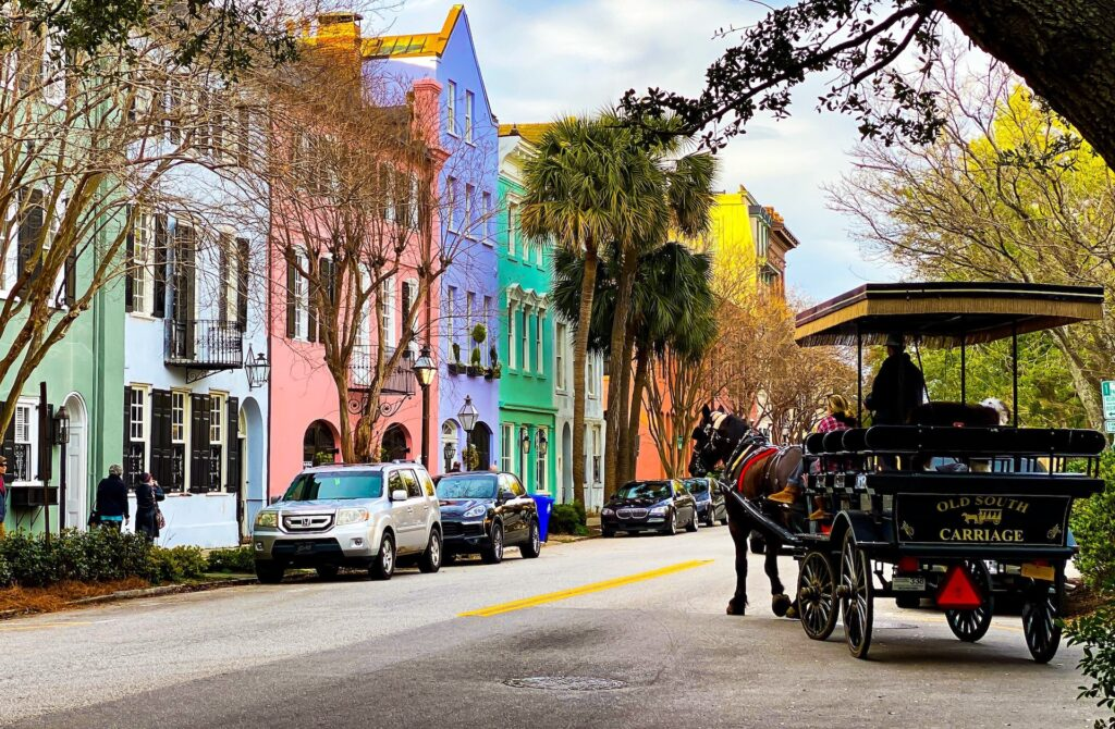 Pastel houses and a horse-drawn carriage in Charleston, South Carolina