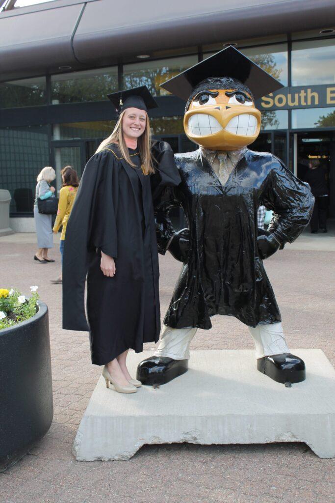 Kenni after graduating from the University of Iowa in Iowa City, Iowa